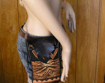 "Tapestry and leather cross body bag, safari print tapestry with black leather & 46"" copper chain strap, loop for belt, bag is 8"" x 5"" x 1"""