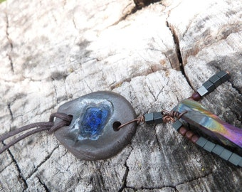 Necklace of hand sculpted clay with recycled blue grass and crystal called blu jeweled.  neckwear - necklace