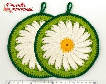 Pair of handmade pot holders made of daisy-shaped crochet