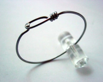Bike jewelry made from a bicycle spoke into a bracelet that I call Plain Jane