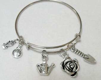 Gardening theme bangle bracelet features rose, watering can charms