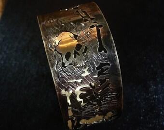 Tormented soul brass cuff bracelet
