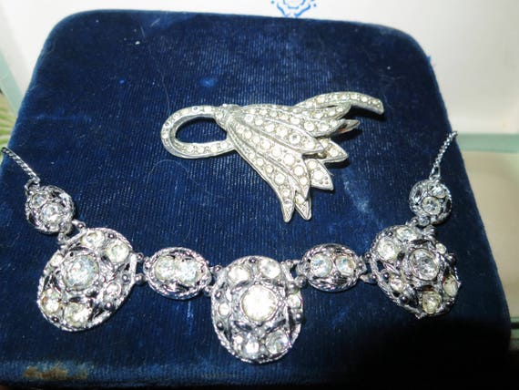 Beautiful Deco vintage silvertone rhinestone necklace and a large bluebell brooch.