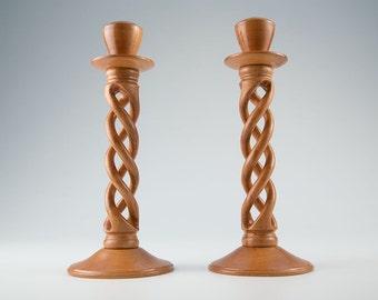 Open triple twist candlesticks