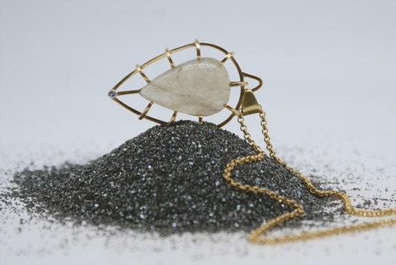 Caged Teardrop - Large Rutilated Quartz with Tanzanite