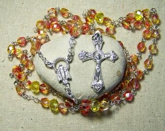 handmade silver Catholic rosary with lemon yellow and fuchsia pink Czech fire polished beads