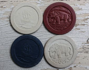 4 Vintage Poker Chips with Lucky the Elephant or Sailing Ship, red, blue and white