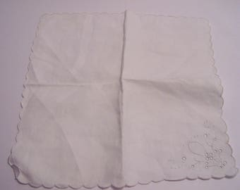 Pair of fine linen hankies with hand-embroidered corners and scalloped edges
