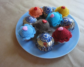 crochet cupcake fibre filled calorie free handmade decoration or miniature pincushion in light blue with a pink heart button
