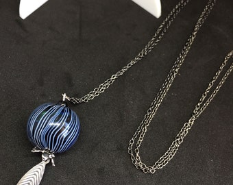 Necklace with large round pearl out of glass and charm silver plated in the shape of sheet