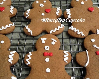 GingerBread Cookies (Qty. 10) with fondant hearts & bow ties and different facial expressions. Homemade edibles by FancyTopCupcake