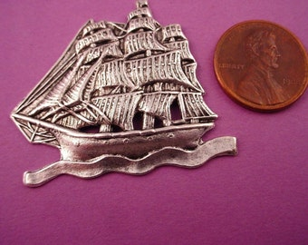 2   silver ox sail ships schooner on water