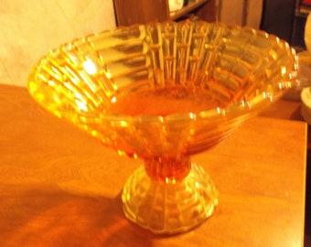 Golden amber vintage carnival glass pedestal bowl.