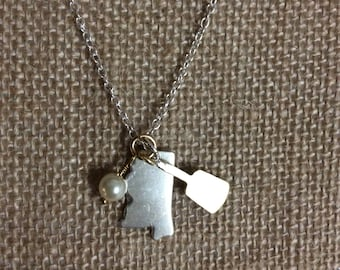Small silver or copper Mississippi necklace with cowbell charm