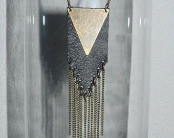 Piece of leather and bronze pendant necklace worn with chains