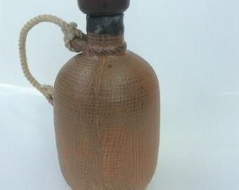 Rare French ceramic licor bottle, Denbac, for distillery Cazanove