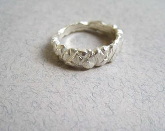 Solid silver carved rock ring