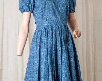 1970s blue print circle skirt dress, w/piping and puffed sleeves.