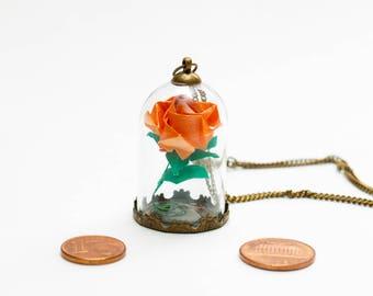 Eternal orange rose origami pendant under glass dome