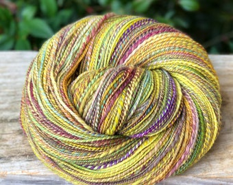 Handspun yarn, pale green, bright yellow, lavender, spring green and pink tones, 100% merino wool, light sport weight, two ply
