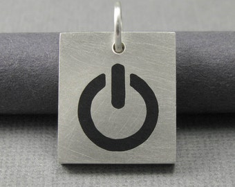 silver power up pendant. iPendant. sterling silver computer pendant. silver on off icon pendant. mac apple power icon pendant mens jewelry