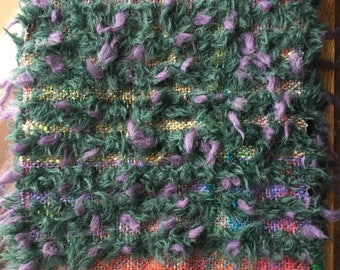 Pure wool scarf handwoven, lambswool with Noro yarn incorporated.Purple & Green very warm