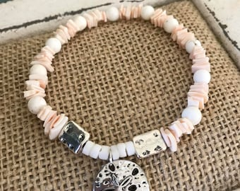 "blush pale pink beaded and shell bracelet with sand dollar charm.  8"" stretch band"