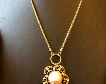Golden crystal stainless steel necklace with a golden stainless steel pendant with crystals and pearl for sale