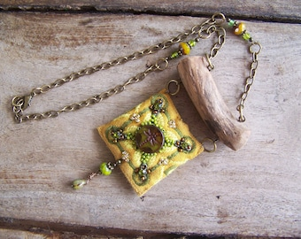 Rustic tribal necklace with dragonfly symbol.