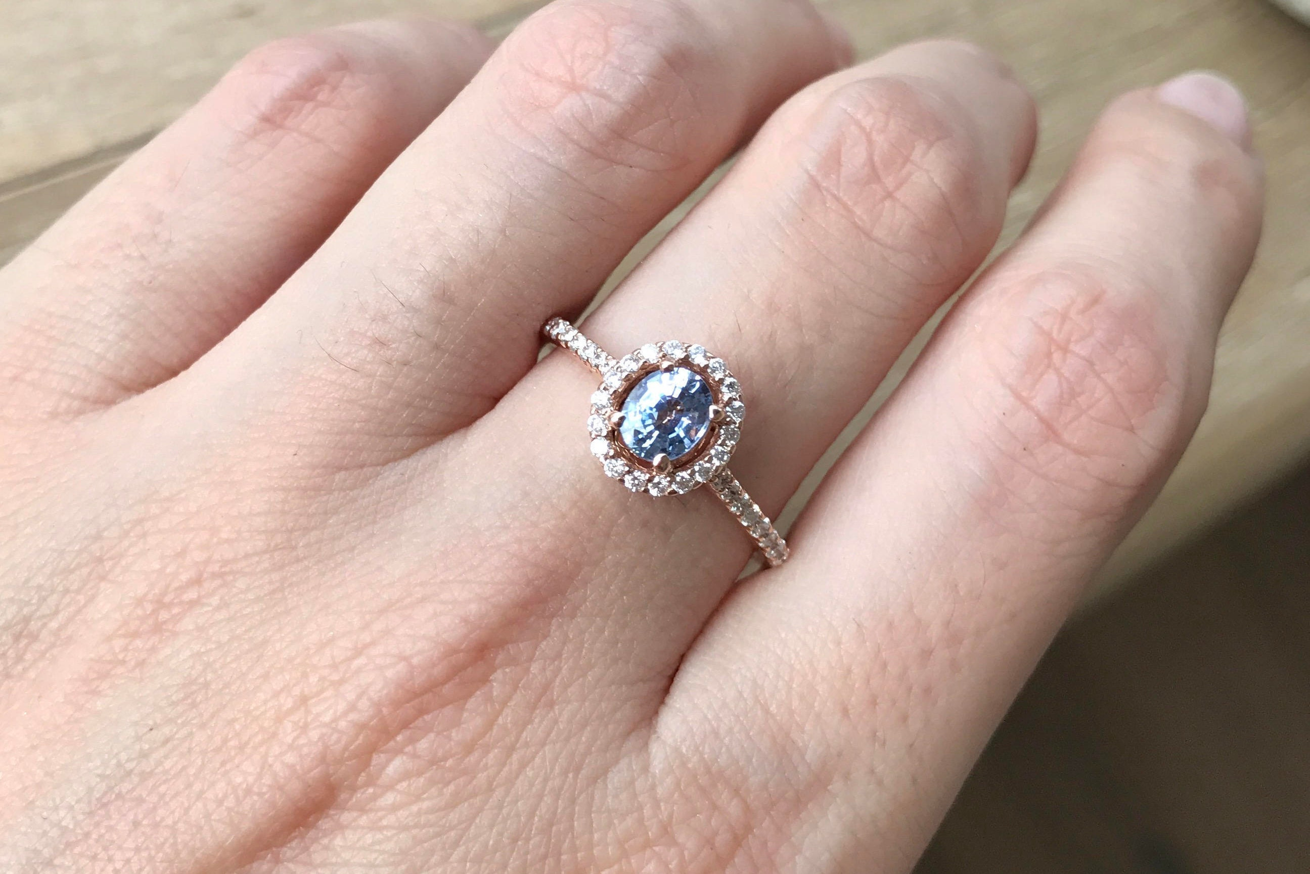 mm gemstones with best article side inspired on aquamarine the diamond oval stone ring for international your center platinum colored three setting engagement detail rings two in vintage a scrollwork sapphire