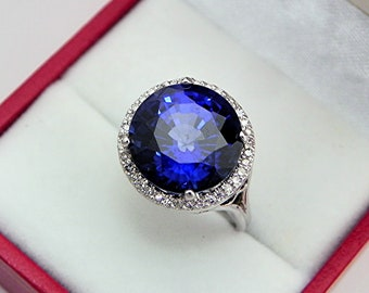 AAAA  Blue Sapphire  12mm  8.60 carats   in 14K White gold Diamond Halo ring with  .15 carats of  VS diamonds 0848