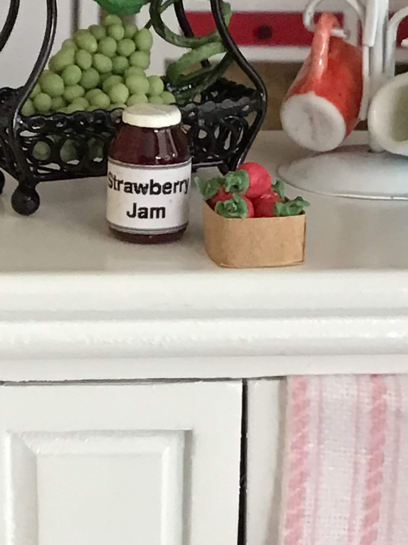 Miniature Strawberries and Jam Jar of Jam