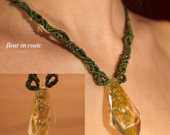 green macrame necklace with goldenrod flowers in a sparkling resin crystal