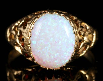 Opal Solitaire 9ct Gold Ring Fancy Design