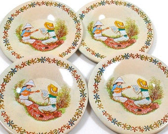 70's tin toy tea saucers with Holly Hobbie style pattern. Set of 4 matching.