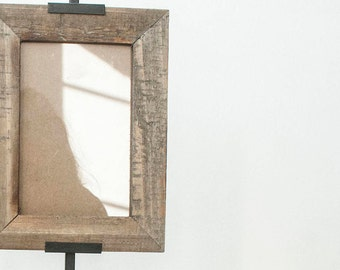 Wooden picture frame with stand.