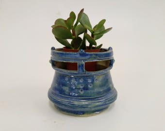 Blue helmet-shaped cactus planter