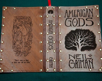 Leather covered copy of American Gods by Neil Gaiman.