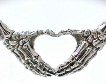skeleton hands necklace making an I heart you symbol  Blue Bayer Design NYC