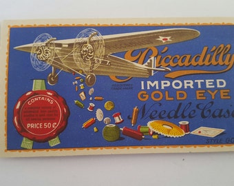 Vintage 1930's Piccadilly Gold Eye needle case 99% complete, Ford Tri-Motor airplane