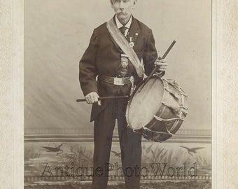 Mustached old man drummer in uniform antique photo