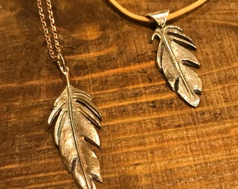 Feather pendant in fine silver with bronze patina