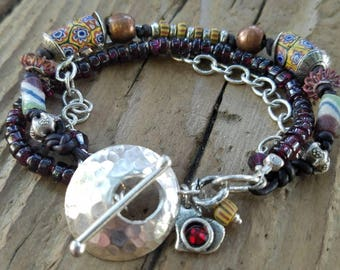 African Trade Bead Bracelet with Garnet and Hill Tribe Silver, Sterling Silver Heart Charm, Valentines Day Gift, January Birthstone