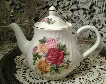 Vintage Teapot with Roses