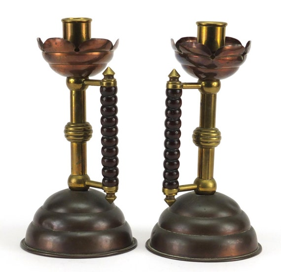 A pair of Arts and crafts Dr Christopher Dresser designed copper and turned wood handles circa 1900