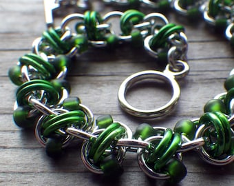 Beaded chain maille bracelet in silver and green anodized aluminum; chainmaille jewelry; beaded chainmaille bracelet; Rapid Track bracelet