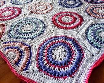 Pink and white circle pattern baby blanket
