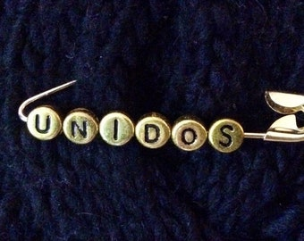 """Unity Safety Pin - """"UNIDOS"""" - Spanish for """"UNITED"""" - your choice of Silver or Gold tones"""