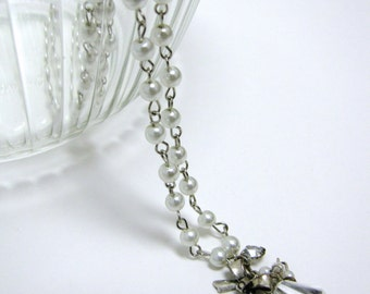 OOAK swarovski crystal, bow and rhinestone pendant with rosary style white pearl wire wrapped necklace