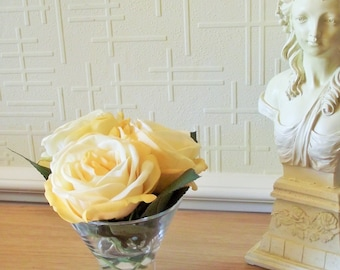 Silk flower arrangement of real-touch roses in glass bowl set in acrylic water